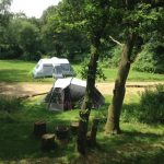 "Two large tents pitched on the very large sheltered pitch known as ""The Glade""."