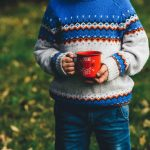 Young lad with coffee mug at campsite