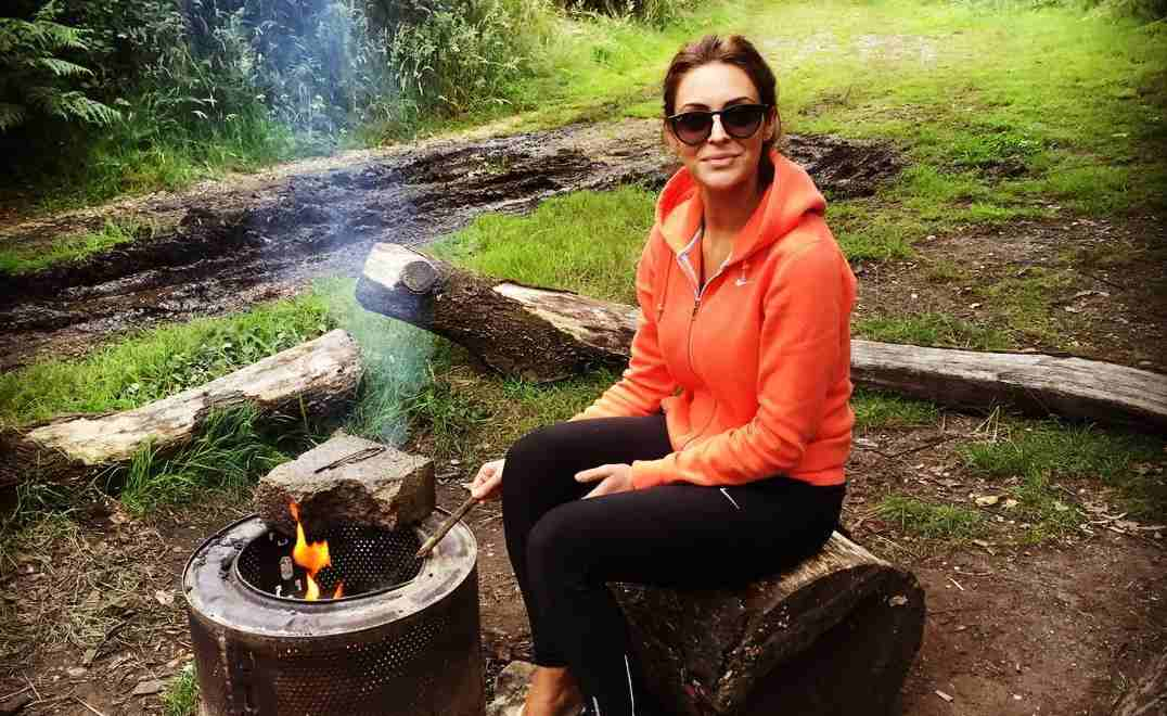 Lady enjoying sitting by one of our eco-fire-pits